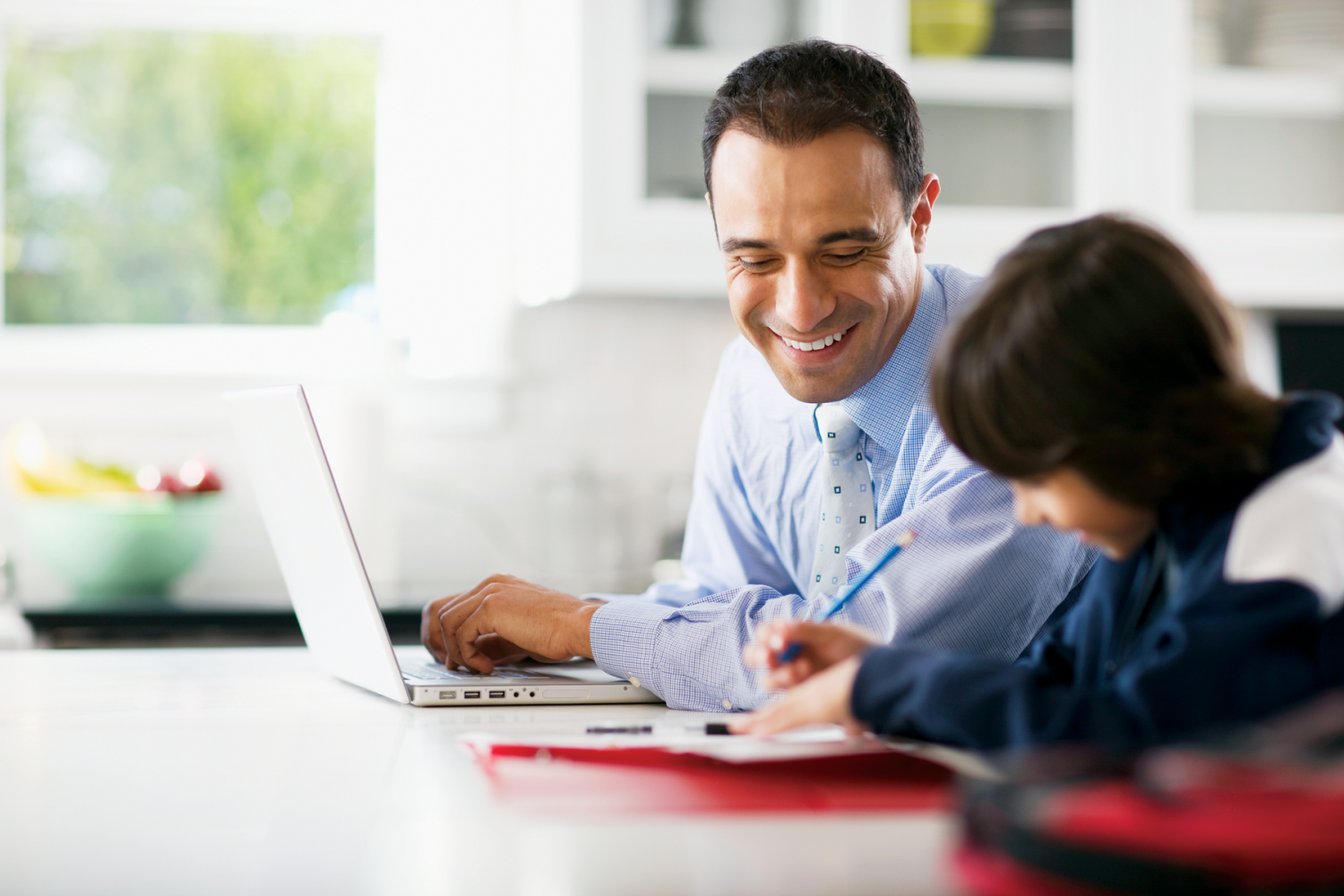 Son-Doing-Homework-as-Father-Uses-Laptop-e1405953269130